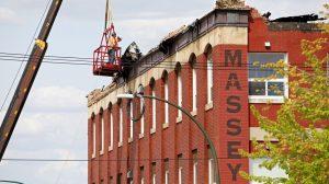 Crane service. Craning manbasket at Massey Manor fire