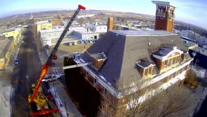 Crane service. new roof support beams into the old Brandon Firehall